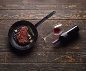 Marbled beef steak with a bottle of wine — Stock Photo