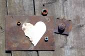 Partially burned paper heart shape — Stock Photo