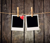 Blank instant photos and paper heart — Stock Photo