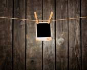 Blank instant photo on the clothesline — Foto de Stock