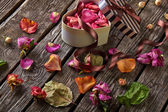 Background with gift box with rose petals — Stock Photo