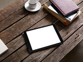 Tablet computer with cup of coffee — Stock Photo