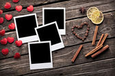 Photo frames with heart shapes and cinnamon — Stock Photo