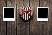 Photo frames and gift box on old wood — Stock Photo