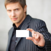 Man showing blank business card — Stock Photo