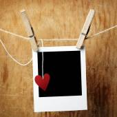 Instant photo and paper heart — Stock Photo