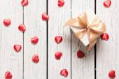 Gift box with small hearts — Stock Photo