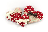 Red hearts family with white and brown bows on white background, Valentine's day concept — Stock Photo