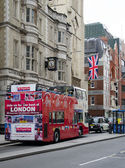 Save Download Preview LONDON, UK - APRIL 22, 2014 Modern red double decker bus April 22, 2014 in Fleet Stree — Stock Photo