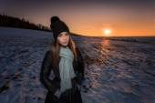 Spotlit portrait of a young girl in winter — Stock Photo
