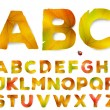 Vector alphabet letters made from autumn leaves, isolated on white — Stock Vector #77480924