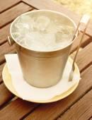 Ice  bucket on wooden table — Stock Photo