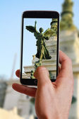 Male hand taking photo of statue in Italian government building in Rome  with cell, mobile phone. Europe travell, Italian holiday. — Stock Photo
