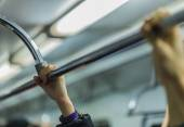 People holding handrail in the metro hand in focus — Stock Photo