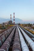 Pipe leading to the thermal power plant in the background perspective — Stock Photo