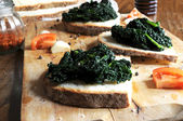 Canapè with black cabbage — Stock Photo