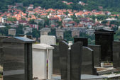 City and cemetery — Stock Photo