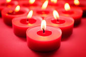 Red candles background — Stock Photo