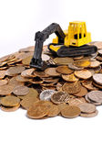 Excavator with coins — Stock Photo