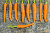 Carrots on old wooden table — Foto Stock