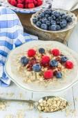 Oatmeal porridge with fresh berries — Stock Photo