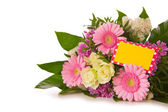Colorful flowers bouquet  and yellow  card. — Stock Photo