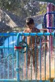Boy in a spray (2) — Stock Photo