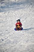 Boy in red on a sled (1) — Stock Photo