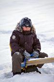 Boy on swing in winter — Stock Photo