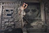 Beautiful girl model looks in the dress — Stock Photo