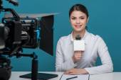 Beautiful girl tv newscaster with pretty smile reports — Stock Photo