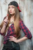 Cheerful Hipster woman with hat and candy — Stock Photo