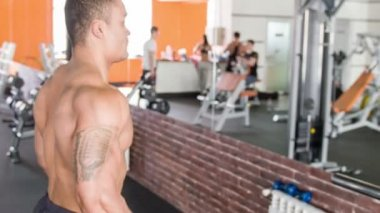 Attractive young athlete is lifting heavy weights — Stock Video