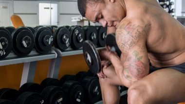 Handsome heavy-weight athlete is training with dumbbell — Stock Video