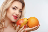 Attractive young girl with two tasty fruits — Stok fotoğraf