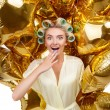 Attractive young blond housewife with astounding gift — Stock Photo #77780528