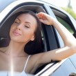 Beautiful young woman is relaxing in her transport — Stock Photo #78261122