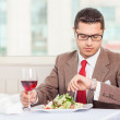 Cheerful young businessman has an appointment in restaurant — Stock Photo #78279042
