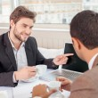 Handsome business partners are discussing a new project — Stock Photo #78279312