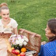 Pretty young women are resting on picnic — Stock Photo #78926974