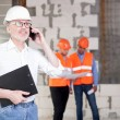 Cheerful construction team is working on new project — Stock Photo #79991034