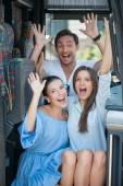 Beautiful girls and guy are resting in public transport — Stock Photo