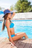 Beautiful young woman is relaxing in swimwear — Stock Photo