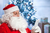 Old Father Christmas is preparing for celebration — Stock Photo