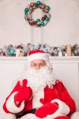 Old Father Christmas is resting and gesturing positively — Stock Photo