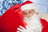 Gorgeous Father Christmas is relaxing after hard work — Stock Photo
