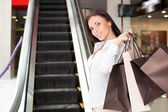 Attractive young styled girl is going shopping — Stock Photo