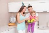 Cute young family is celebrating their housewarming — Stock Photo