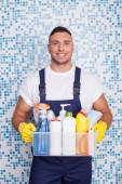 Attractive young stay-at-home man is cleaning his house — Stock Photo