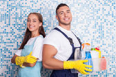 Cheerful washers are doing clean-up in bathroom — Stock Photo